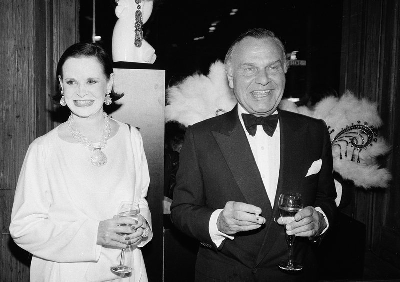 FILE - In this Nov. 9, 1982 file photo, fashion designers Gloria Vanderbilt, left, and Bill Blass are shown at the 90th birthday celebration of artist Erte in New York. Vanderbilt, the intrepid heiress, artist and romantic who began her extraordinary life as the