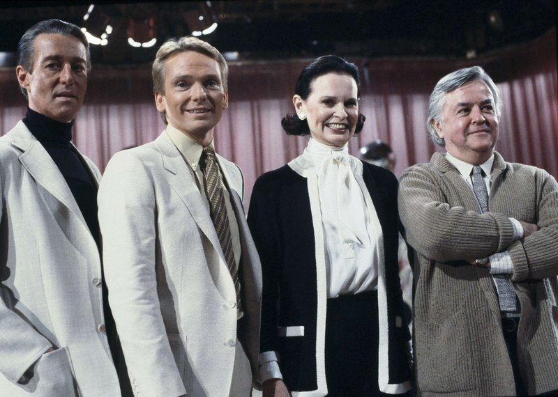 FILE - In this Feb. 3, 1981 file photo, fashion designers, from left to right: Halston; Bob Mackie; Gloria Vanderbilt and Geoffrey Beene pose on the set of the