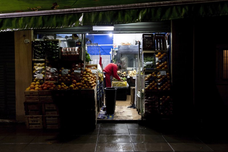 A vendor readies his shop in the Chacarita neighborhood in Buenos Aires, Argentina, early Monday morning, June 17, 2019. As lights turned back on across Argentina, Uruguay and Paraguay after a massive blackout that hit tens of millions people, authorities were still largely in the dark about what caused the collapse of the interconnected grid and were tallying the damage from the unforeseen disaster. (AP Photo/Tomas F. Cuesta)