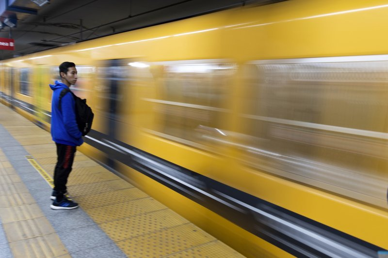 A commuter stands on a platform as a subway races past in downtown in Buenos Aires, Argentina, Monday, June 17, 2019. As lights turned back on across Argentina, Uruguay and Paraguay after a massive blackout that hit tens of millions people, authorities were still largely in the dark about what caused the collapse of the interconnected grid and were tallying the damage from the unforeseen disaster. (AP Photo/Tomas F. Cuesta)