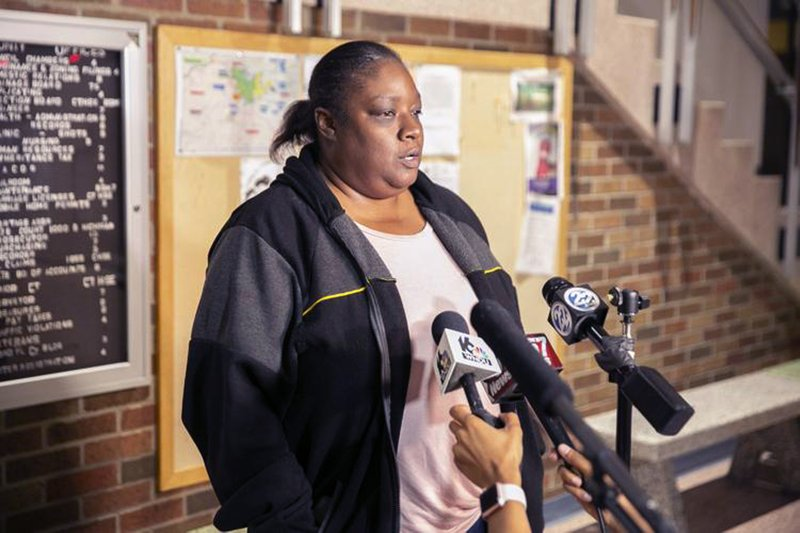 Shafonia Logan, wife of Eric Logan, speaks with the media Sunday, June 16, 2019 in South Bend, Ind. A police officer fatally shot Eric Logan, 53, a black man, Sunday in South Bend,  the city where Democratic presidential candidate Pete Buttigieg is mayor. Buttigieg returned Sunday to South Bend, where he said the death would be thoroughly investigated. He has also canceled a Monday campaign stop in New York. (Santiago Flores/South Bend Tribune via AP)