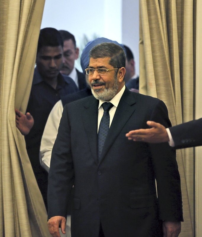 FILE - In this March 19, 2013 file photo, then Egyptian President Mohammed Morsi arrives for a signing of agreements ceremony in New Delhi, India. On Monday June 17, 2019, Egypt's state TV said the country's ousted President Mohammed Morsi, 67, collapsed during a court session and died. It said it occurred while he was attending a court trial on espionage charges. Morsi, who hailed from Egypt's largest Islamist group, the now outlawed Muslim Brotherhood, was elected president in 2012 in the country's first free elections following the ouster the year before of longtime leader Hosni Mubarak. (AP Photo/Manish Swarup, File)