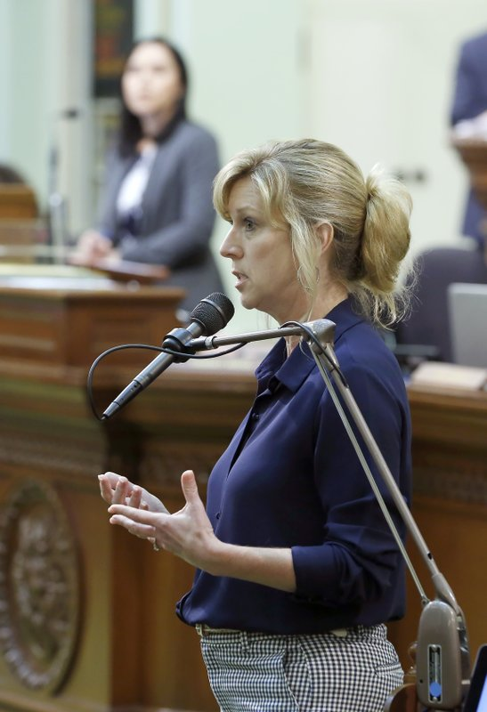 Assemblywoman Christy Smith, D-Santa Clarita, urges lawmakers to approve a measure to raise fees on phones to pay for an upgrade to the 911 system during the Assembly session in Sacramento, Calif., Monday, June 17, 2019. The Assembly approved the bill, SB96. (AP Photo/Rich Pedroncelli)