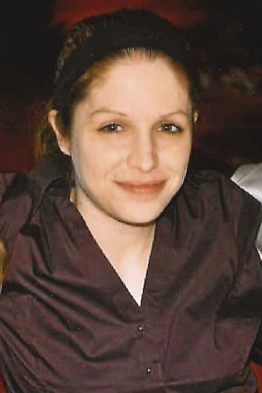 This undated photo provided by the family in May 2019 shows Janene Wallace, who killed herself in 2015 in a Delaware County, Pa., jail. The 35-year-old Wallace, who suffered from mental illness and paranoia, was in solitary 51 of 52 days for a probation violation. When she threatened to choke herself, a guard told her to go ahead. The family won a $7 million settlement. (Courtesy Susanne Wallace via AP)
