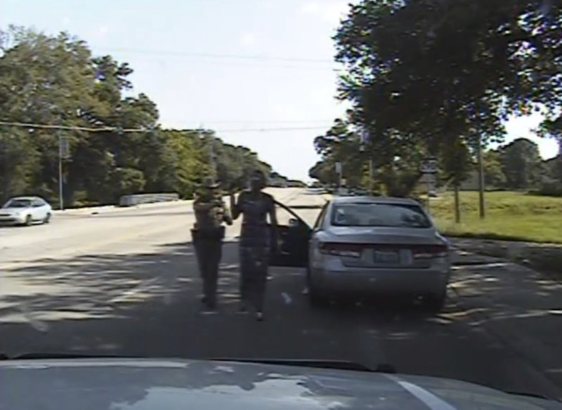 FILE - In this July 10, 2015 image made from dashcam video provided by the Texas Department of Public Safety, trooper Brian Encinia arrests Sandra Bland after she became combative during a routine traffic stop in Waller County, Texas. Bland was taken to the Waller County Jail that day and was found dead in her cell on July 13. (Texas Department of Public Safety via AP)