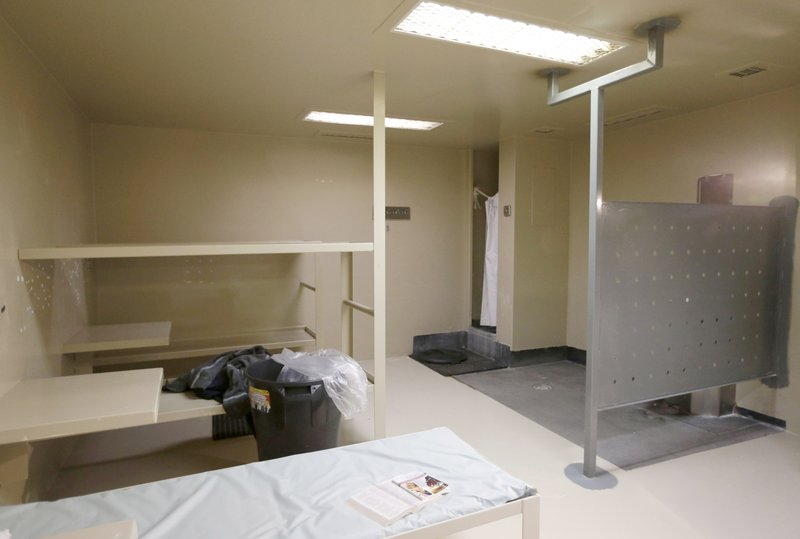 FILE - This July 22, 2015 file photo shows the Waller County jail cell in Hempstead, Texas, where Sandra Bland was found dead. In Texas, the Sandra Bland Act became law in 2017, mandating mental health training for law enforcement and making it easier for those arrested to receive a personal bond if they have a mental illness or substance abuse problem. Bland killed herself after being jailed for a minor traffic violation. (AP Photo/Pat Sullivan, File)