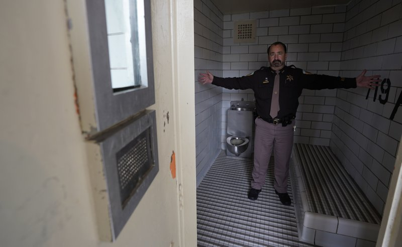 Dane County, Wis., Sheriff David Mahoney stands in a solitary confinement cell at the county jail. An advocate for the mentally ill, Mahoney says he sometimes has to lock certain inmates in these cells even though he calls the conditions