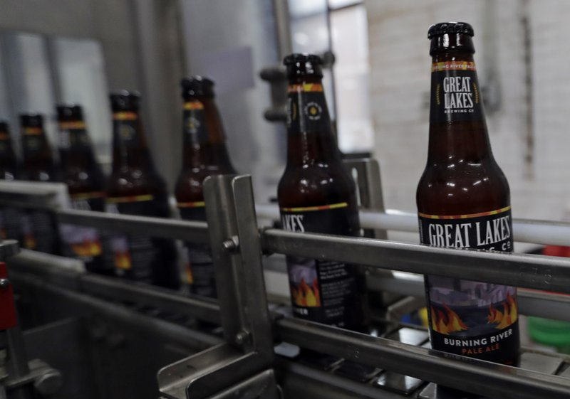Bottles of Burning River beer make their way down the assembly line in the bottling process at the Great Lakes Brewing Company, Monday, June 17, 2019, in Cleveland. The