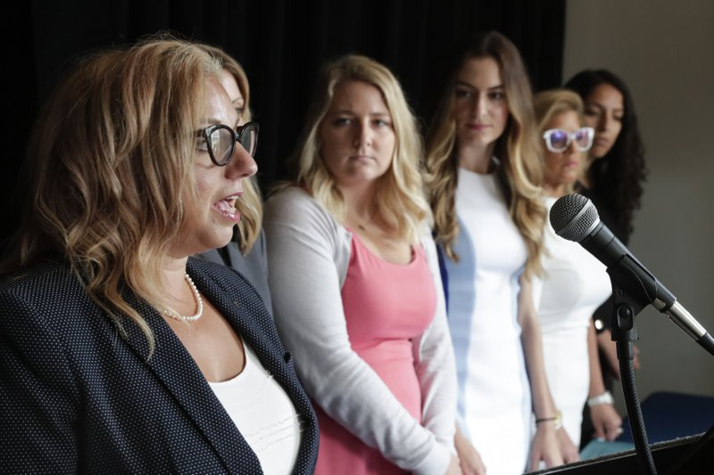 Attorney Hannah Kaufman Joseph, left, announces during a press conference in Indianapolis Tuesday, June 18, 2019, a lawsuit against Indiana Attorney General Curtis Hill and the State of Indiana on behalf of four women who accused the attorney general of drunkenly groping them at a party. The women, right to left, are Samantha Lozano, State Rep. Mara Candelaria Reardon, Niki DaSilva and Gabrielle McLemore. (AP Photo/Michael Conroy)