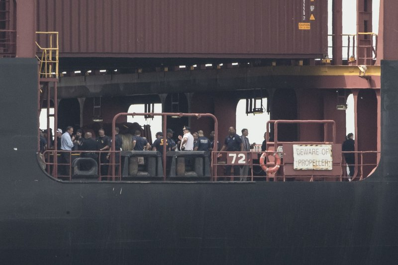 Officials gather on the decks of a container ship on the Delaware River in Philadelphia, Tuesday, June 18, 2019.U.S. authorities have seized more than $1 billion worth of cocaine from a ship at a Philadelphia port, calling it one of the largest drug busts in American history. The U.S. attorney's office in Philadelphia announced the massive bust on Twitter on Tuesday afternoon. Officials said agents seized about 16.5 tons (15 metric tons) of cocaine from a large ship at the Packer Marine Terminal. (AP Photo/Matt Rourke)