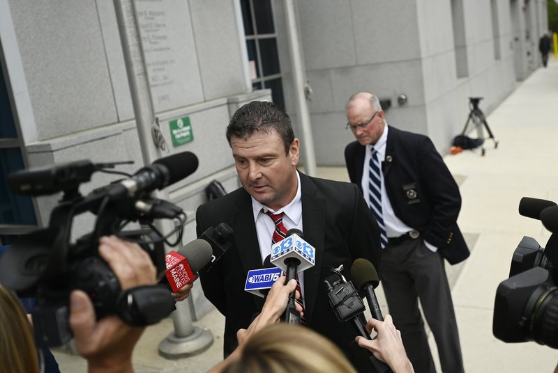 Defense attorney Verne Paradie speaks with the press following the murder trial of John D. Williams, Tuesday, June 18, 2019, in Portland, Maine.  Williams, accused of placing a gun to the neck of a sheriff's deputy and pulling the trigger, was convicted of murder Tuesday after a trial that focused on his state of mind. (Shawn Patrick Ouellette/Portland Press Herald via AP)