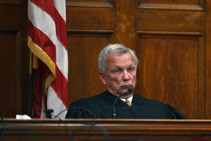 Superior Court Justice Robert Mullen listens to closing arguments in the murder trial of John D. Williams  Tuesday, June 18, 2019, in Portland, Maine.  Williams, accused of placing a gun to the neck of a sheriff's deputy and pulling the trigger, was convicted of murder Tuesday after a trial that focused on his state of mind. (Shawn Patrick Ouellette/Portland Press Herald via AP, Pool)