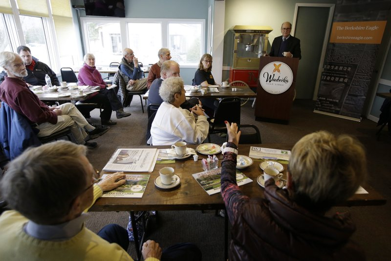 In this Wednesday, April 10, 2019 photo President of the Berkshire Eagle newspaper Fred Rutberg, top right, engages people during a
