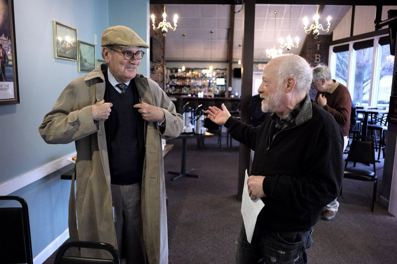 In this Wednesday, April 10, 2019 photo President of The Berkshire Eagle newspaper Fred Rutberg, left, speaks with Lanny Lambert, of Pittsfield, Mass., right, at the conclusion of a