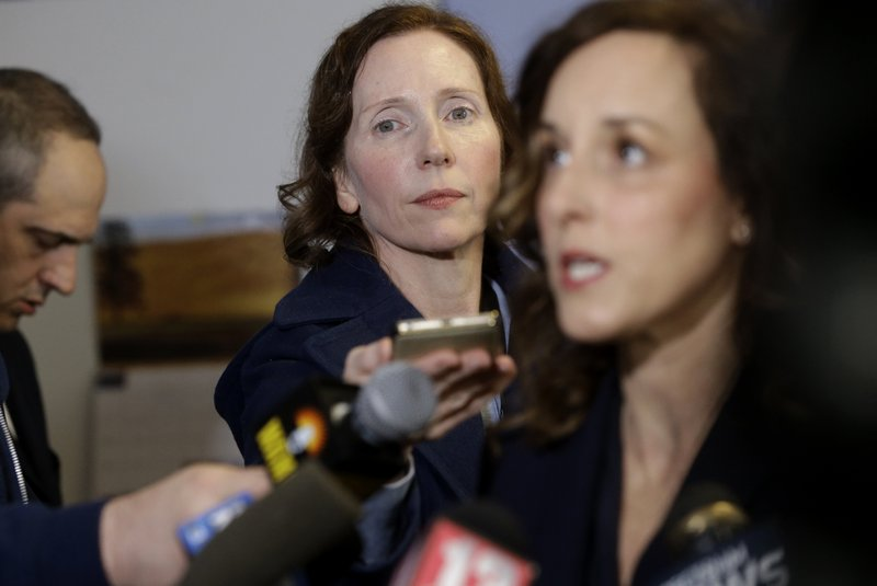 In this Tuesday, April 9, 2019 photo Berkshire Eagle reporter Heather Bellows, center left, attends a news conference with Berkshire County District Attorney Andrea Harrington, right, in Pittsfield, Mass. Bellow was recruited as an investigative reporter two years ago as part of a hiring flurry that brought dozens of new jobs to The Berkshire Eagle and its three sister Vermont papers. (AP Photo/Steven Senne)