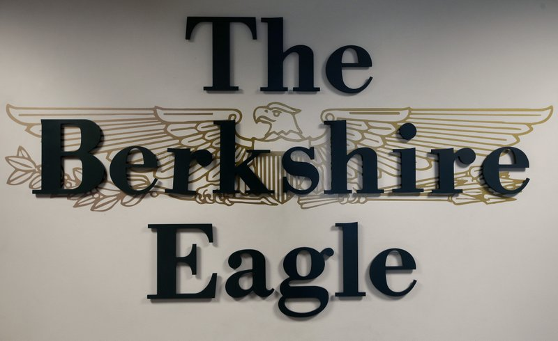 In this Tuesday, April 9, 2019 photo a The Berkshire Eagle emblem is attached to a wall inside the newspaper, in Pittsfield, Mass. The paper now features a new 12-page lifestyle section for Sunday editions, a reconstituted editorial board, a new monthly magazine, and the newspaper print edition is wider. That level of expansion is stunning in an era where U.S. newspaper newsroom employment has shrunk by nearly half over the past 15 years. (AP Photo/Steven Senne)