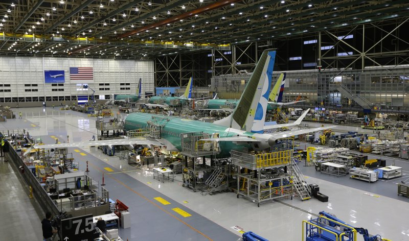 FILE - This Dec. 7, 2015, file photo shows the second Boeing 737 MAX airplane being built on the assembly line in Renton, Wash. The president of the pilots' union at American Airlines says Boeing made mistakes in its design of the 737 Max and not telling pilots about new flight-control software on the plane. (AP Photo/Ted S. Warren, File)