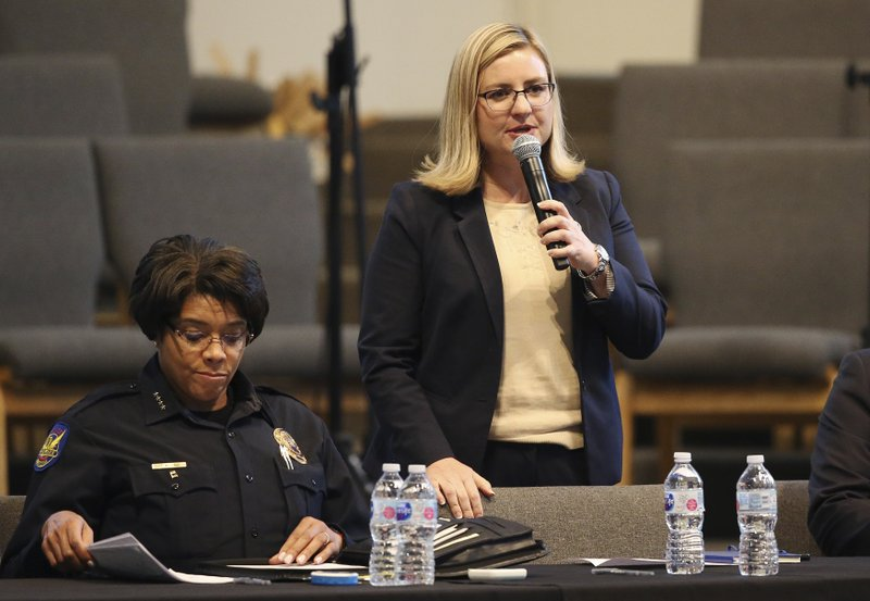 Phoenix Mayor Kate Gallego, right, addresses the audience as Phoenix Police Chief Jeri Williams, left, goes through notes at a community meeting, Tuesday, June 18, 2019, in Phoenix. The community meeting stems from reaction to a videotaped encounter that surfaced recently of Dravon Ames and his pregnant fiancee, Iesha Harper, having had guns aimed at them by Phoenix police during a response to a shoplifting report, as well as the issue of recent police-involved shootings in the community. (AP Photo/Ross D. Franklin)