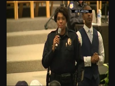Phoenix Police Chief Jeri Williams promised change after being booed during a community meeting Tuesday night. The meeting follows the national outcry over a videotaped encounter involving police and a family after a shoplifting report. (June 19)