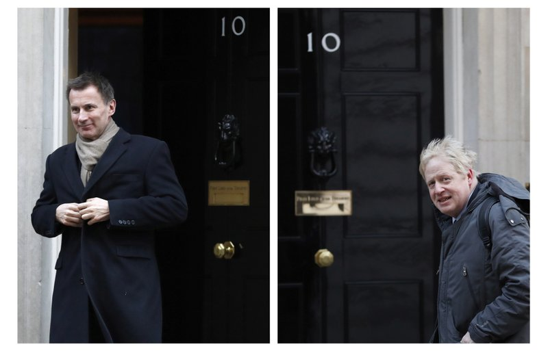 FILE - In this two photo file combo image, Jeremy Hunt, left, and Boris Johnson, right, pictured outside 10 Downing Street, who are the final two contenders for leadership of the Conservative Party, it is announced Thursday June 20, 2019.  Following elimination votes Britain's Conservative Party members will vote for the final two contenders with the winner due to replace Prime Minister Theresa May as party leader and prime minister. (AP Photo FILE/Alastair Grant, Alastair Grant)