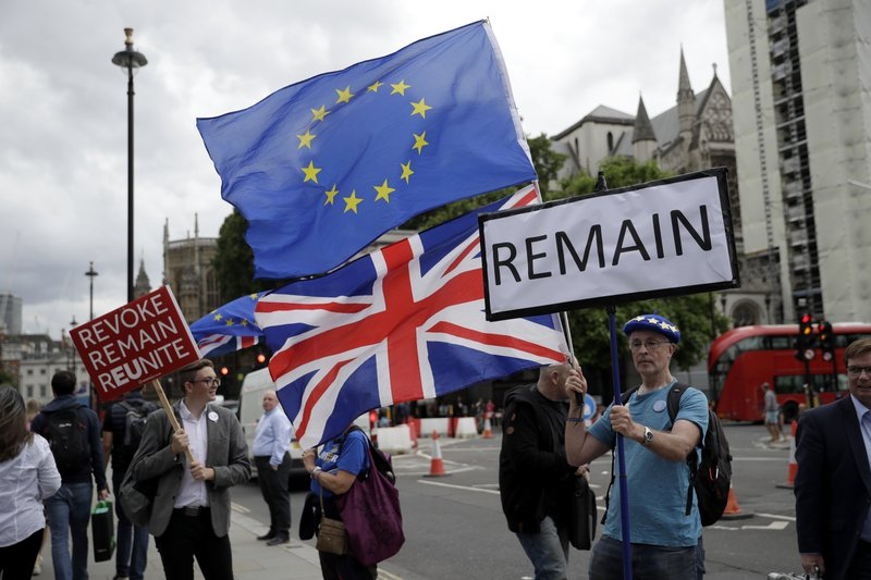 Anti-Brexit remain supporters protest outside the Houses of Parliament in London, Thursday, June 20, 2019. The contest to become Britain's next prime minister is down to its final three candidates, with Environment Secretary Michael Gove and Foreign Secretary Jeremy Hunt chasing front-runner Boris Johnson for a spot in a deciding runoff. (AP Photo/Matt Dunham)
