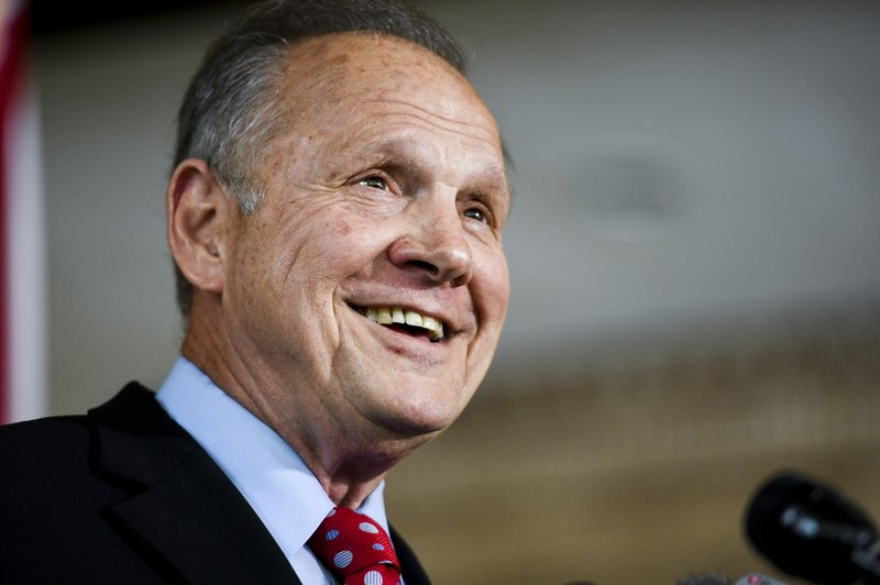 Former Alabama Chief Justice Roy Moore smiles as he announces his run for the republican nomination for U.S. Senate, Thursday, June 20, 2019, in Montgomery, Ala. (AP Photo/Julie Bennett)