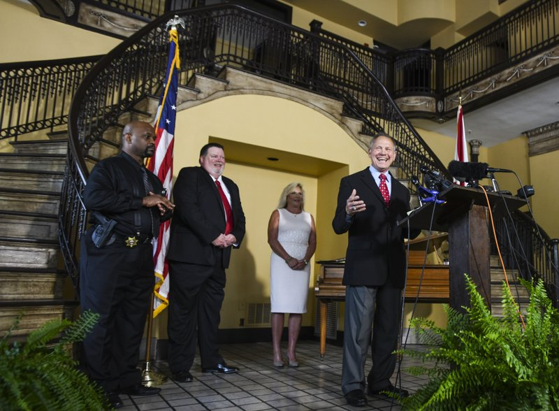 Former Alabama Chief Justice Roy Moore, right,  announces his run for the republican nomination for U.S. Senate, Thursday, June 20, 2019, in Montgomery, Ala. (AP Photo/Julie Bennett)