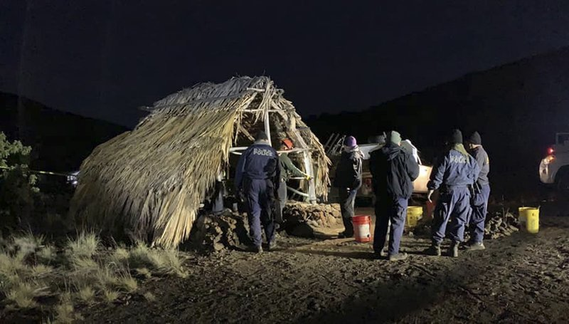 In this photo provided by Pi'ikea Keawekane-Stafford, state and county officials remove Native Hawaiian structures from Mauna Kea, Thursday, June 20, 2019. After years of protests and legal battles, Hawaii officials announced Thursday that a massive telescope which will allow scientists to peer into the most distant reaches of our early universe will be built on a volcano that some consider sacred. The state has issued a