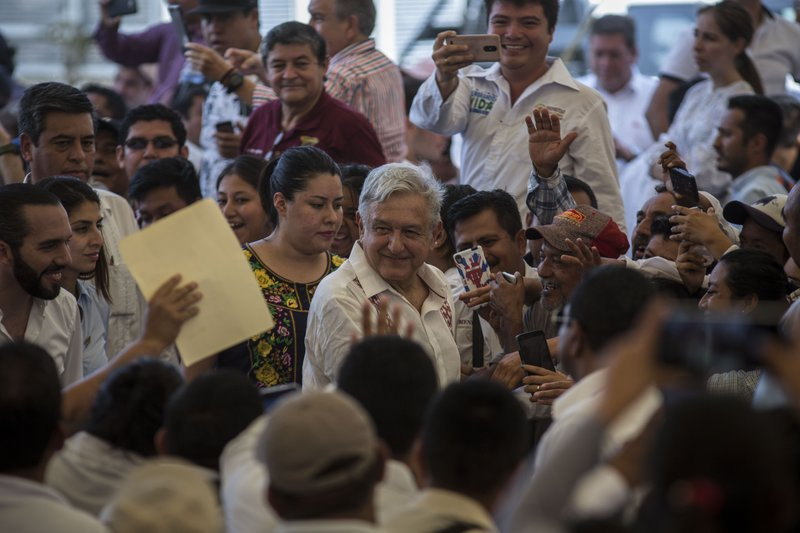 Mexican President Andres Manuel Lopez Obrador arrives to a military nature reserve for an event with El Salvadorian President Nayib Bukele near the border town of Tapachula, Mexico, Thursday, June 20, 2019. Lopez Obrador met with El Salvador's president to discuss a development plan that aims to slow a surge of mostly Central American migrants toward the U.S. border. (AP Photo/Oliver de Ros)