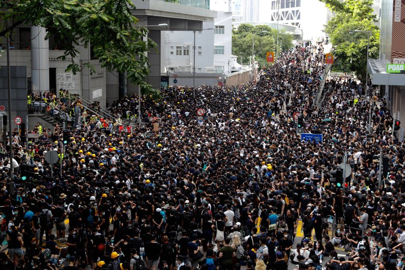 Protesters gather outside the police headquarters in Hong Kong Friday, June 21, 2019. Several hundred mainly student protesters gathered outside Hong Kong government offices Friday morning, with some blocking traffic on a major thoroughfare, after a deadline passed for meeting their demands related to controversial extradition legislation that many see as eroding the territory's judicial independence. (AP Photo/Vincent Yu)