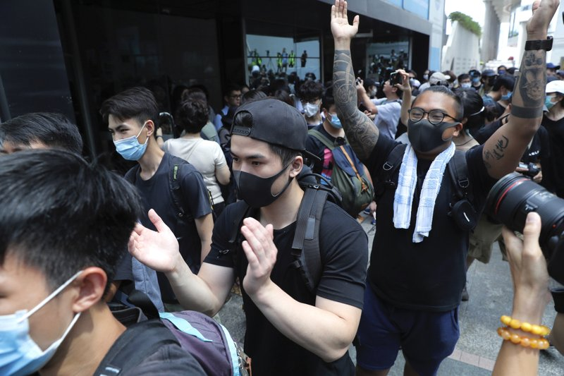 Protesters march outside the Hong Kong Revenue Tower in an attempt to block government work in Hong Kong Friday, June 21, 2019. Several hundred mainly student protesters gathered outside Hong Kong government offices Friday morning, with some blocking traffic on a major thoroughfare, after a deadline passed for meeting their demands related to controversial extradition legislation that many see as eroding the territory's judicial independence. (AP Photo/Kin Cheung)