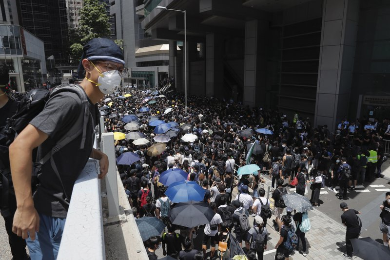 Protesters surround the police headquarters in Hong Kong on Friday, June 21, 2019. Several hundred mainly student protesters gathered outside Hong Kong government offices Friday morning, with some blocking traffic on a major thoroughfare, after a deadline passed for meeting their demands related to controversial extradition legislation that many see as eroding the territory's judicial independence. (AP Photo/Kin Cheung)