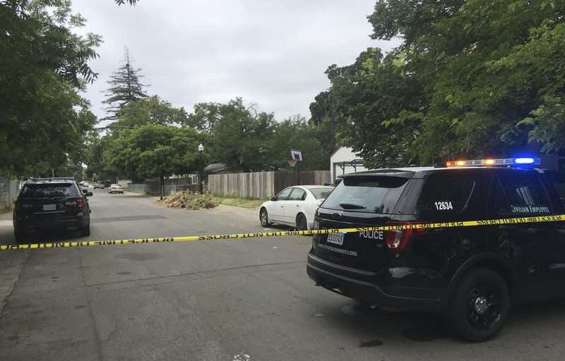 Sacramento police continue to block off the scene where a police officer was fatally shot in Sacramento, Calif., Thursday, June 20, 2019. A man suspected of fatally shooting a Sacramento police officer responding to a domestic violence call surrendered after an 8-hour standoff in which he fired his rifle on and off, preventing officers from getting to their colleague as she lay wounded for nearly an hour, authorities said Thursday. (AP Photo/Don Thompson)