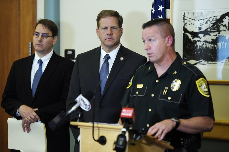 From left, Coos County Attorney John McCormick, New Hampshire Gov. Chris Sununu and New Hampshire State Police Col. Chris Wagner attend a news conference at the Coos County Courthouse, Saturday, June 22, 2019 in Lancaster, N.H. Investigators pleaded Saturday for members of the public to come forward with information that could help them determine why a pickup truck hauling a trailer collided with a group of motorcycles on a rural highway. (Paul Hayes/Caledonian-Record via AP)