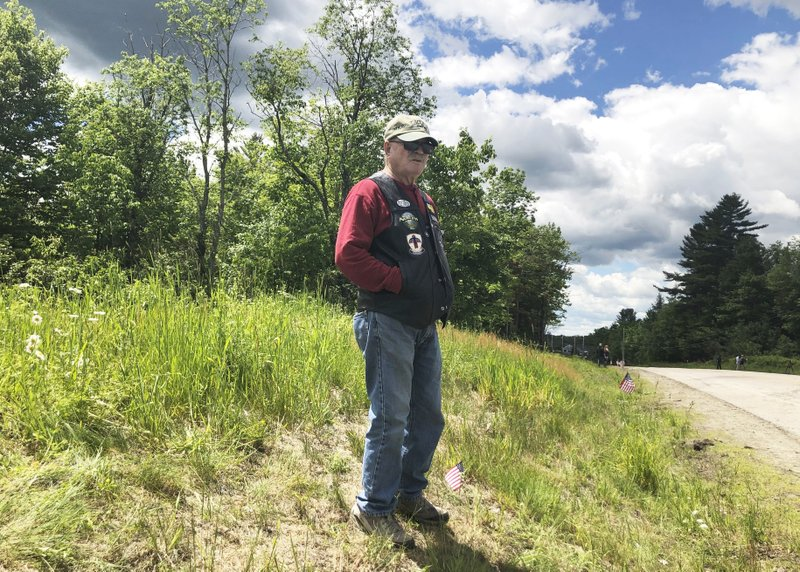 Bill Brown, a 73-year-old Vietnam vet from Bethlehem, N.H., visits an area in Randolph, N.H., Saturday, June 22, 2019, where motorcyclists with a club comprised of ex-United States Marines collided with a pickup truck on a rural highway late Friday. Investigators pleaded Saturday for members of the public to come forward with information that could help them determine why the pickup truck hauling a trailer collided with a group of motorcycles on a rural highway, killing several bikers. (AP Photo/Michael Casey)
