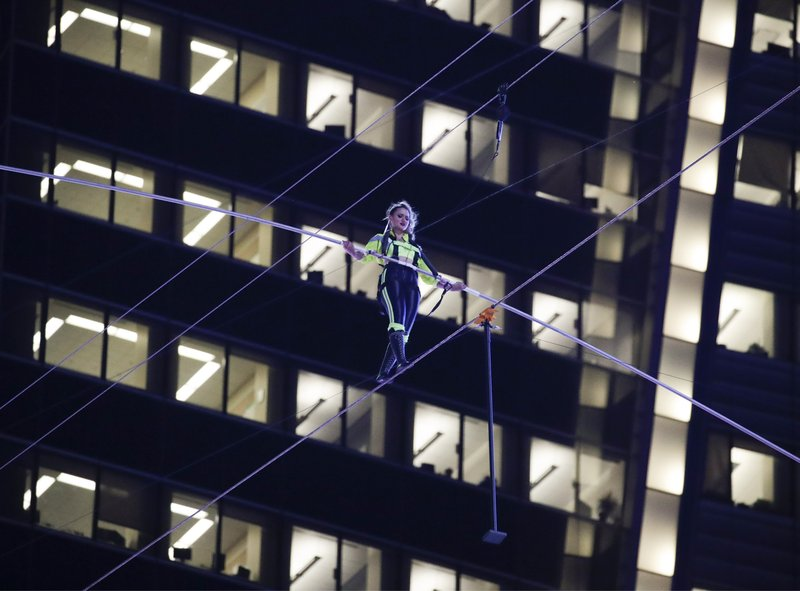 Aerialist Lijana Wallenda walks on a high wire above Times Square, Sunday, June 23, 2019, in New York. (AP Photo/Jason Szenes)