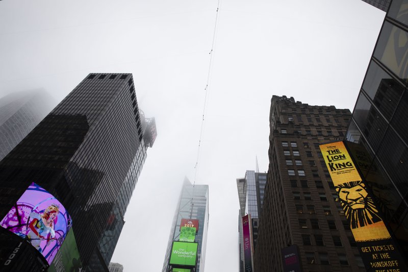 A high-wire crosses Times Square, Thursday, June 20, 2019 in New York. Performers Nik and Lijana Wallenda will cross Times Square on the high wire on Sunday. (AP Photo/Mark Lennihan)