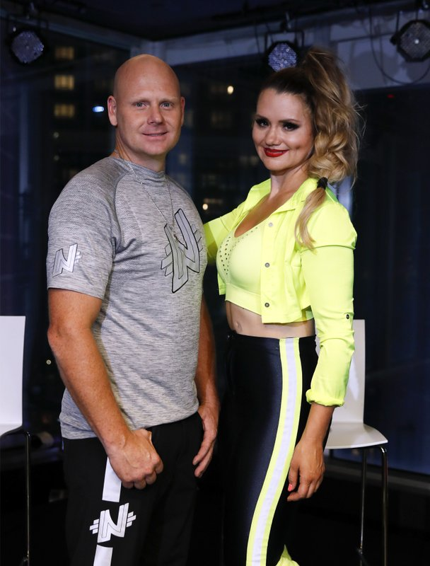 Aerialists Nik Wallenda, left, and his sister Lijana pose before a news conference after their high wire walk above Times Square, Sunday, June 23, 2019, in New York. (AP Photo/Jason Szenes)