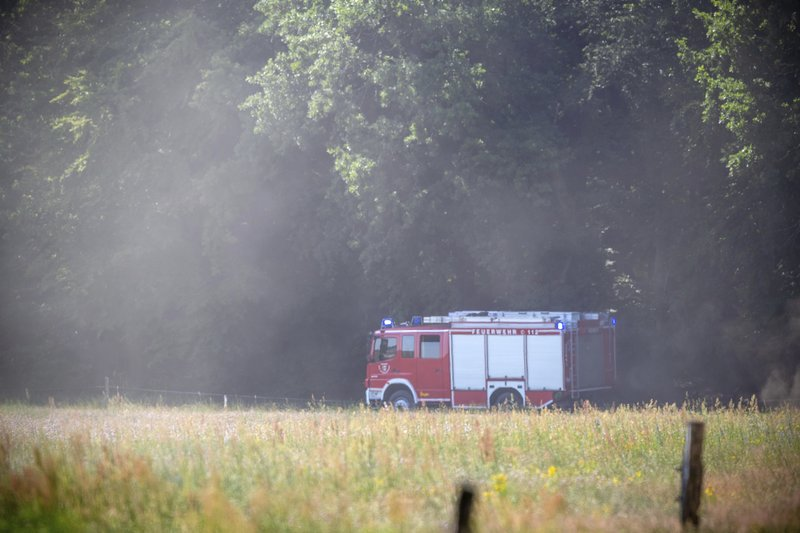A fire truck is pictured in Nossentiner Huette, eastern Germany on Monday, June 24, 2019 near the place where two German Eurofighter military planes crashed earlier today. (Jens Buettner/dpa via AP)