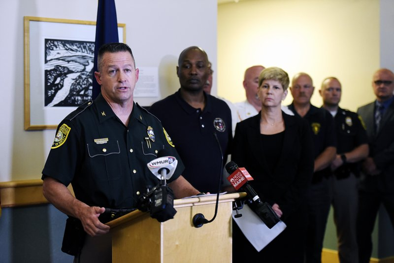 New Hampshire State Police Col. Chris Wagner addresses the media during a news conference, Saturday, June 22, 2019 at the Coos County Courthouse in Lancaster, N.H. Investigators pleaded Saturday for members of the public to come forward with information that could help them determine why a pickup truck hauling a trailer collided with a group of motorcycles on a rural highway. (Paul Hayes/Caledonian-Record via AP)