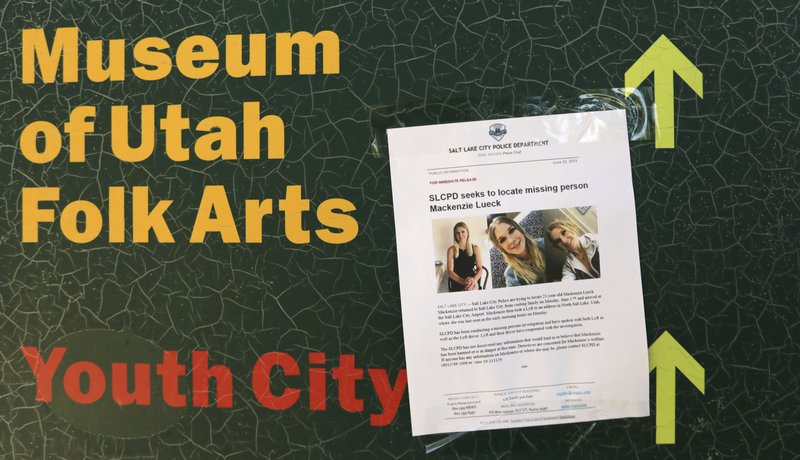 CORRECTS SPELLING OF LUECK - A poster of MacKenzie Lueck is shown in Liberty Park Monday, June 24, 2019, in Salt Lake City. Police and friends are investigating the disappearance of the 23-year-old University of Utah student, whose last communication with her family said she arrived at Salt Lake City International Airport on Monday, June 17. (AP Photo/Rick Bowmer)