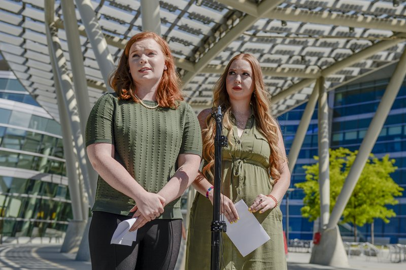In this Sunday, June 23, 2019 photo, Ashley Fine and Kennedy Stoner, close friends of missing person Mackenzie Lueck, speak during a press conference outside the Salt Lake City Police Department in Salt Lake City. Police and friends are investigating the disappearance of the 23-year-old University of Utah student, whose last communication with her family said she arrived at Salt Lake City International Airport on Monday, June 17. (Leah Hogsten/The Salt Lake Tribune via AP)