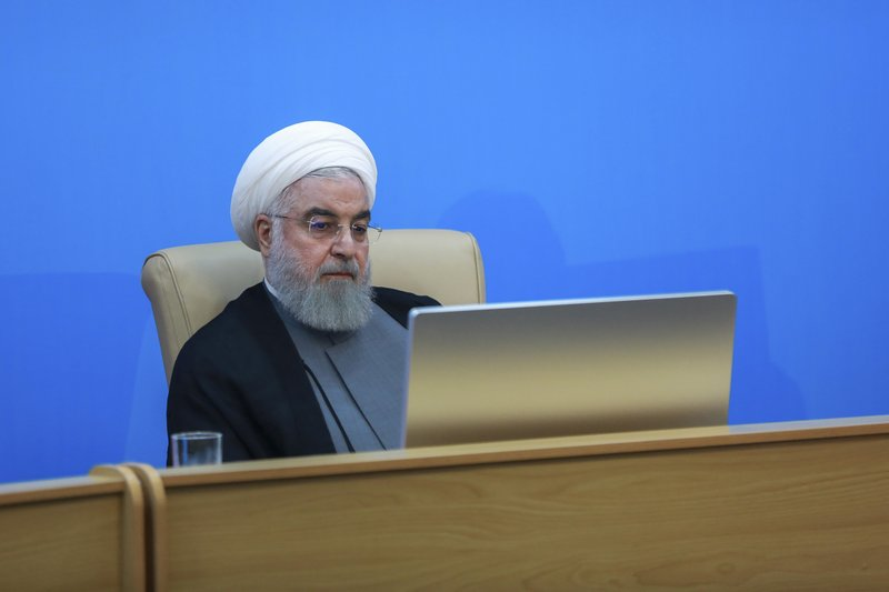In this photo released by the official website of the office of the Iranian Presidency, President Hassan Rouhani attends a meeting with the Health Ministry officials in Tehran, Iran, Tuesday, June 25, 2019. Rouhani said the new U.S. sanctions targeting the Islamic Republic's supreme leader and others are