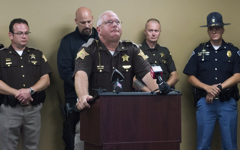 Perry County Sheriff Alan Malone, center, becomes emotional while providing details on the accidental death of 11-year-old Isabelle Meyer while attending the Girl Scouts of Southwestern Indiana's Camp Koch at the Perry County Sheriff's Office in Tell City, Ind., Tuesday, June 25, 2019. Isabelle was fatally injured when a tree suddenly fell on her and three others as they hiked along a gravel road at a southern Indiana campground, authorities said. (MaCabe Brown/Evansville Courier & Press via AP)