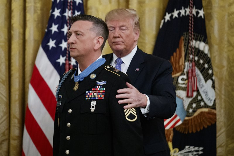 President Donald Trump awards the Medal of Honor to Army Staff Sgt. David Bellavia in the East Room of the White House in Washington, Tuesday, June 25, 2019, for conspicuous gallantry while serving in support of Operation Phantom Fury in Fallujah, Iraq. (AP Photo/Carolyn Kaster)