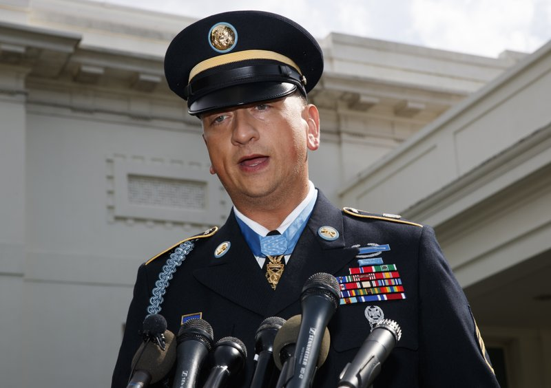 Medal of Honor recipient Army Staff Sgt. David Bellavia speaks to media outside the West Wing of the White House in Washington, Tuesday, June 25, 2019, after receiving the Medal of Honor for conspicuous gallantry while serving in support of Operation Phantom Fury in Fallujah, Iraq. (AP Photo/Carolyn Kaster)
