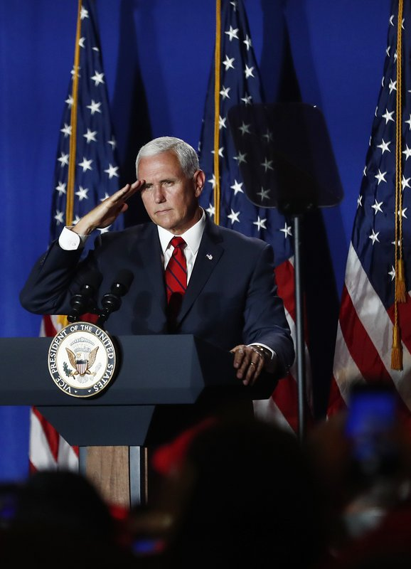 Vice President Mike Pence salutes during a rally on Tuesday, June 25, 2019 in Miami. (AP Photo/Brynn Anderson)