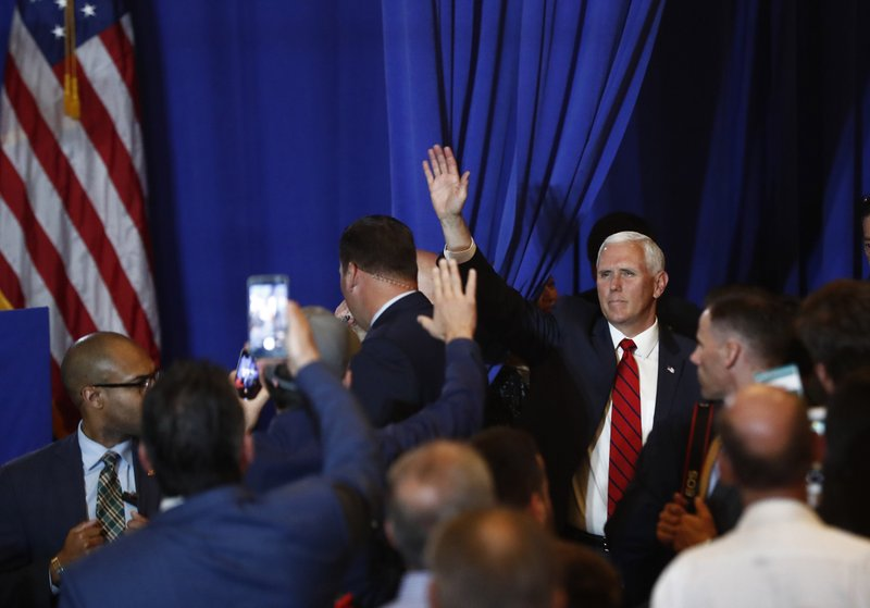Vice President Mike Pence waves to the crowd after he speaks during a rally on Tuesday, June 25, 2019 in Miami. (AP Photo/Brynn Anderson)