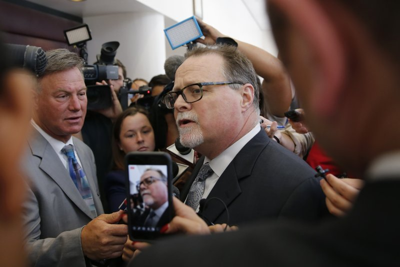 Sacramento County Assistant Chief Deputy District Attorney Rod Norgaard talks to reporters after the first court appearance of Adel Sambrano Ramos in the shooting death of Sacramento Police Officer Tara O'Sullivan, in Sacramento County Superior Court, Monday, June 24, 2019, in Sacramento, Calif. Norgaard defended police from criticism that they took 45 minutes to rescue O'Sullivan. (AP Photo/Rich Pedroncelli)