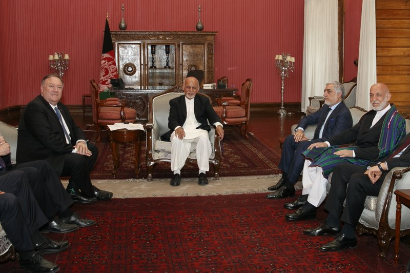 Secretary of State Mike Pompeo, left, meets with Afghan President Ashraf Ghani, Afghan Chief Executive Officer Abdullah Abdullah, and former Afghan President Hamid Karzai, right, at the Presidential Palace in Kabul, Afghanistan, Tuesday, June 25, 2019, during an unannounced stop. (AP Photo/Jacquelyn Martin, Pool)